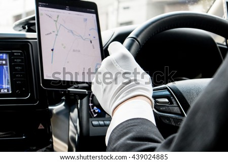 Luxury Chauffeur Driving with GPS Foto stock ©