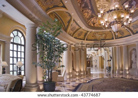 Luxury classic colonnade corridor issued from hall with ornate luster