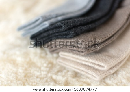Luxury comfortable cashmere bed socks. Four pairs of luxury cashmere wool socks in shop. Wool made from cashmere goats made in Mongolia is the best quality and also very expensive wool. Сток-фото ©