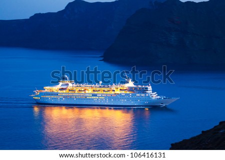 Luxury Cruise Ship Sailing at Sunset