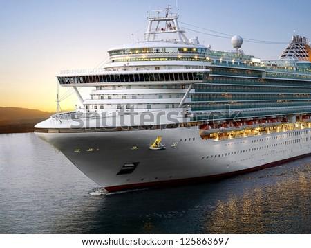 Luxury cruise ship sailing from port on sunrise