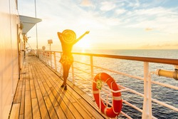 Luxury cruise ship travel elegant woman having fun carefree on deck enjoying watching sunset on Europe cruising destination vacation. Summer european mediterranean cruiseship sailing away on holiday.