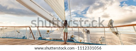 Luxury cruise ship vacation woman on deck banner panorama. Travel in Tahiti on sail boat, exotic destination. Tourism in oceania. Boat sailing away on tropical getaway #1112331056