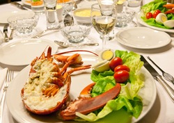 Luxury dinner table with fresh lobster and salad