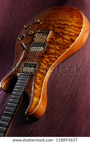 Luxury electric guitar on the red textured background