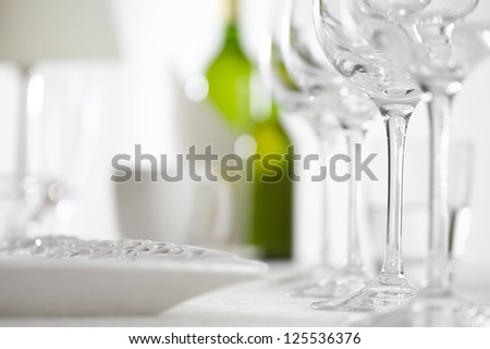 Luxury elegant dinner table setting in restaurant or hotel with wine glasses and white wine