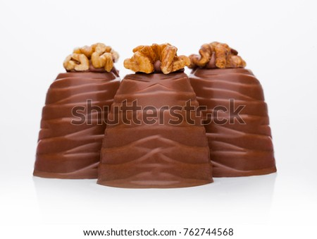 Luxury elegant milk chocolate candy with walnut on white background #762744568
