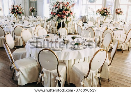 Luxury, elegant wedding reception table arrangement, floral centerpiece #376890619