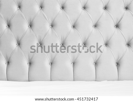 Luxury empty bedroom interior background, soft gray headboard and white bedding sheets on wide double bed #451732417