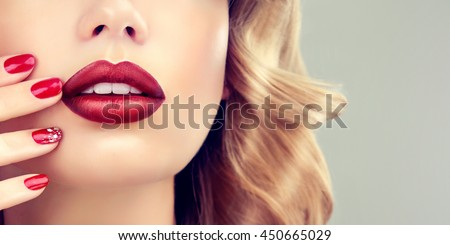 Luxury fashion style, manicure nail , cosmetics and makeup . Red  beauty lips  .