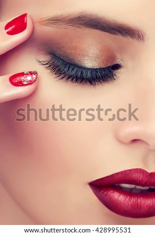 Luxury fashion style, manicure nail , cosmetics and makeup . Red lips  and  long eyelashes  .
