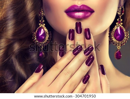 Luxury fashion style, nails manicure, cosmetics ,make-up and curly hair . Makeup in shades of purple and violet earrings