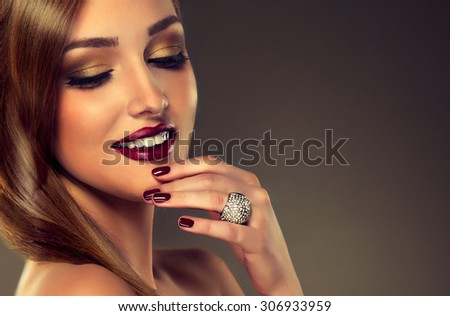 Luxury fashion style, nails manicure, cosmetics ,make-up .beautiful   teeth    white smile , earrings and ring
