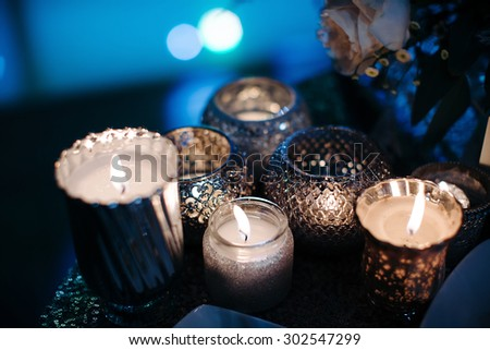 Luxury, fashion wedding decoration wedding, wedding table, restaurant. Candles, glasses, glare, color close-up. Wedding ceremony in the winter.