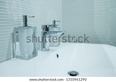 Luxury faucet mixer in a beautiful  bathroom #1310961290