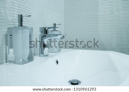 Luxury faucet mixer in a beautiful  bathroom #1310961293