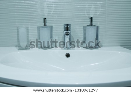 Luxury faucet mixer in a beautiful  bathroom #1310961299