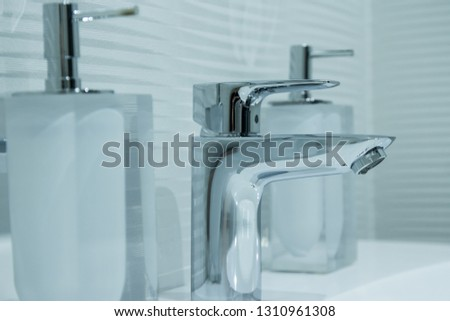 Luxury faucet mixer in a beautiful  bathroom #1310961308