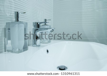 Luxury faucet mixer in a beautiful  bathroom #1310961311