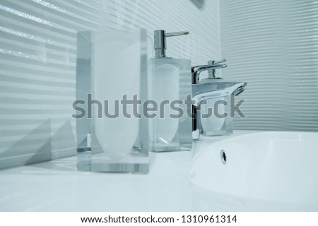 Luxury faucet mixer in a beautiful  bathroom #1310961314