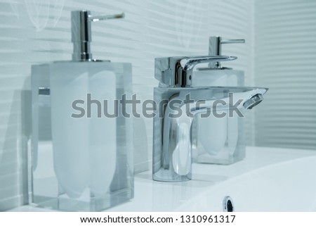 Luxury faucet mixer in a beautiful  bathroom #1310961317