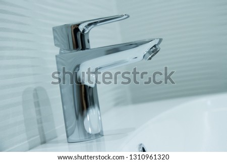 Luxury faucet mixer in a beautiful  bathroom #1310961320