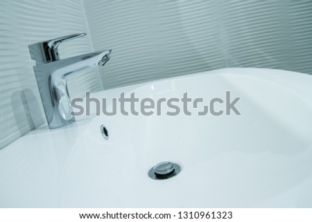 Luxury faucet mixer in a beautiful  bathroom #1310961323