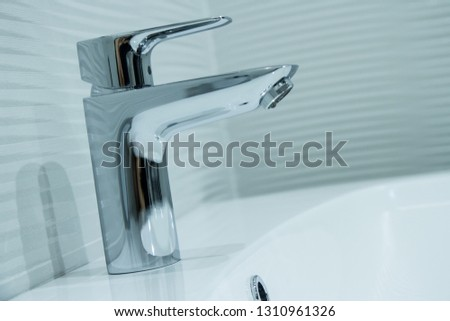 Luxury faucet mixer in a beautiful  bathroom #1310961326