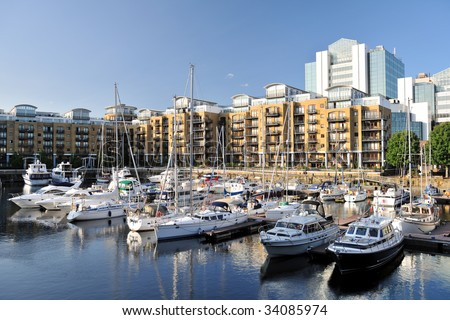 Luxury flats, City Quay, and yachts moored in the east dock marina, St Katherine Dock, London, England, UK, Europe
