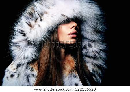 Luxury girl with long brown hair in a fur coat. The Snow Queen. Cold girl.