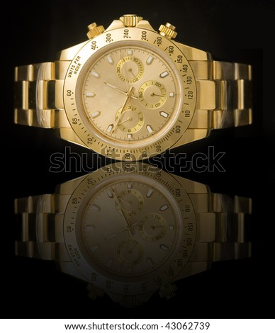 Luxury gold watch isolated on black background with reflection