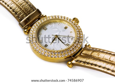 Luxury gold wristwatch with gems isolated on white