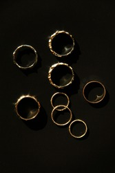 Luxury golden rings on the black background, Flat lay, Top view, ring photo.