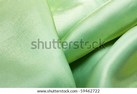 Luxury Green Satin Background with curvy folds.