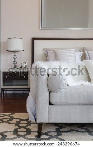 luxury grey sofa on carpet in luxury bedroom at home