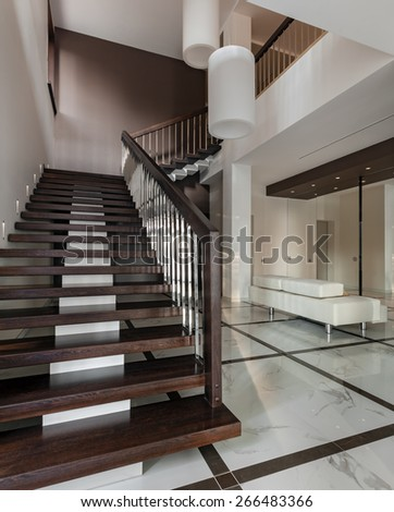 Luxury hall with staircase in modern style