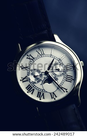 Luxury hand watch with leather wrist let stylised with Instagram retro blue effect