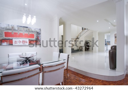 Luxury home dining room interior with overlooking staircase and hallway - stock photo
