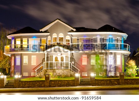 Luxury home exterior in the night time with the lights
