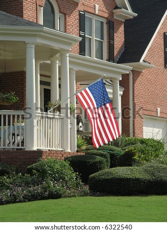 Luxury Home Exterior with American Flag
