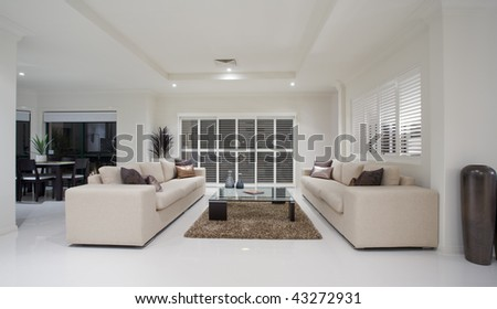 Dining Room on Luxury Home Living Room Interior Overlooking Dining Room Stock Photo