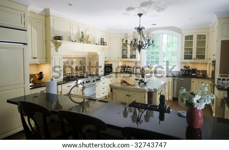 Luxury Home Modern Custom Kitchen With Wine And Baguettes On ...