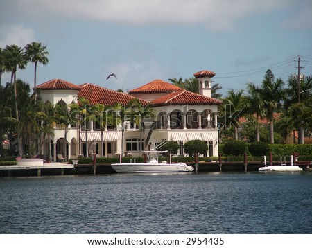 Luxury home on a pier or marina with a private yacht