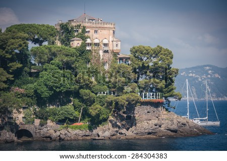 luxury home surrounded the port of Portofino, with the beach and luxury boats