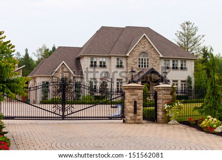 Luxury home with a double wrought-iron gate
