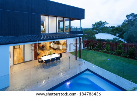 Luxury home with swimming pool at dusk