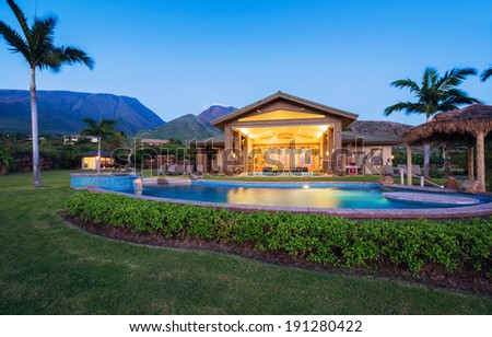 Luxury home with swimming pool at sunset, Tropical Villa Resort