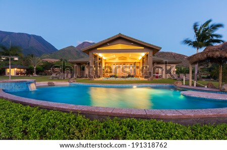 Luxury home with swimming pool at sunset. Tropical Villa Resort