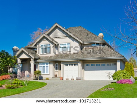 Luxury home with the blue sky as a background in suburbs of Vancouver, Canada.