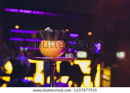 Luxury hookah with orange. Exotic bowl with fruit. Hookah lounge. Fruits and coals. Glamours relax. Narghile and water pipe. #1237877935